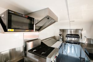 Inside the custom built Cabbage Tree Coffee food trailer kitchen.