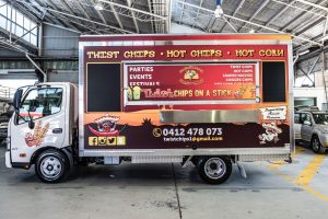 Side view of the Twist Chips truck in the shop