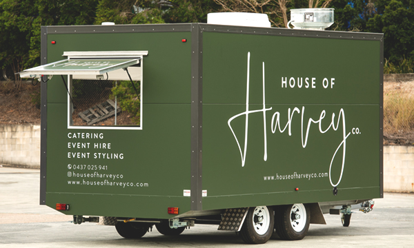 Side view of House of Harvey's catering van.