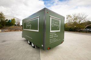 Side view of House of Harvey's catering van.