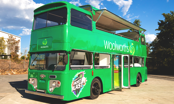 Side view of Woolworths' promotional bus.