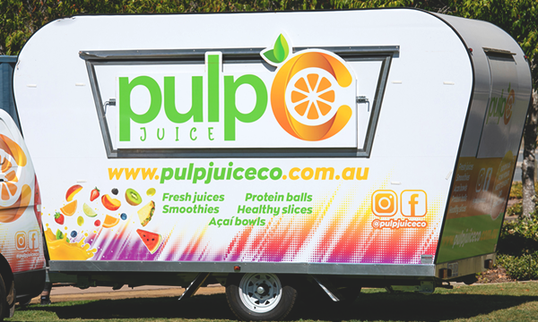 Side view of Pulp Juice Co's juice van.