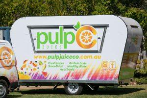 Side view of Pulp Juice Co's juice van.