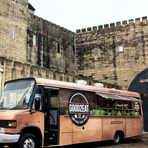 Side view of the Good2Eat Catering bus.