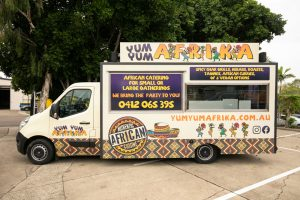 Side view of the Yum Yum Afrika food truck.