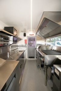 Inside view of the Yum Yum Afrika food truck kitchen.